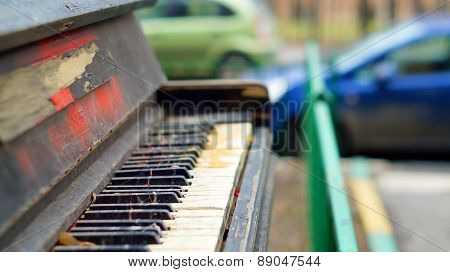 Old pianoforte left outdoors