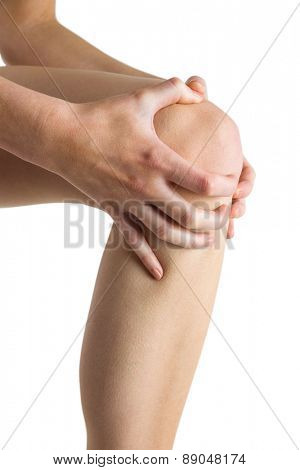 Woman with knee injury on white background