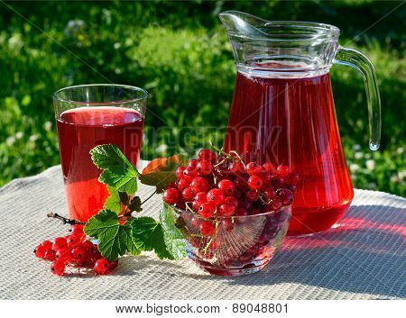 A Drink Red Currant In The Glass And Carafe