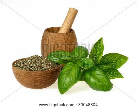 Dried Basil Crushed With Green Leaves In A Wooden Bowl