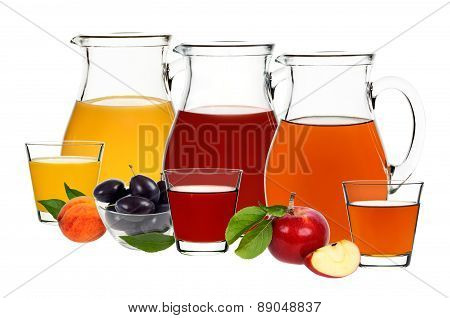 Apple, Plum And Peach Juice In Glasses And Decanters