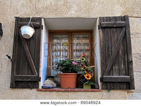 French Rustic Window With Old Wood Shutters In Stone Rural House, Provence, France.