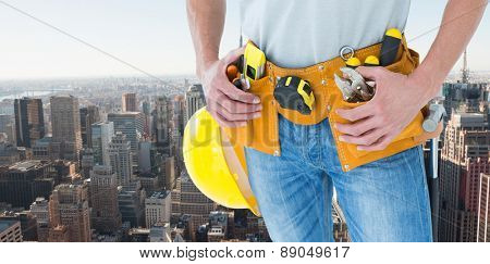Technician with tool belt around waist against new york