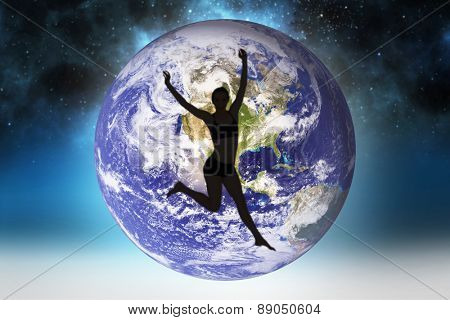 Full length of a sporty young woman jumping against starry night sky