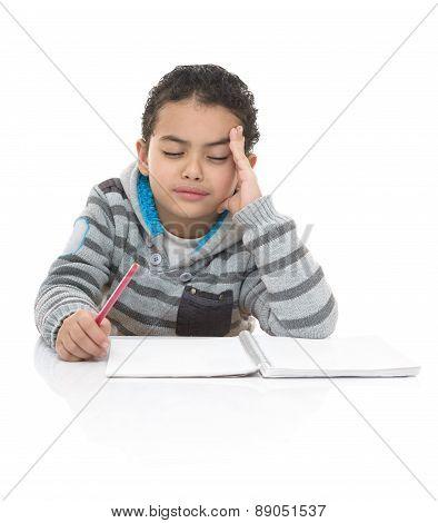 Cute Young Schoolboy Thinking Hard