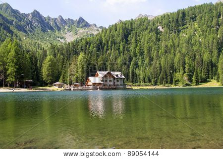 Shelter In High Mountain With Lake
