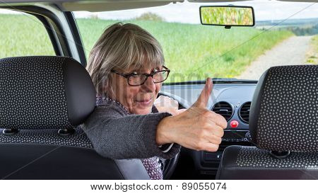 Senior Woman In The Car With Thumbs Up