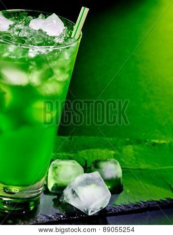 Green drink  with crushed ice . Half of glass.
