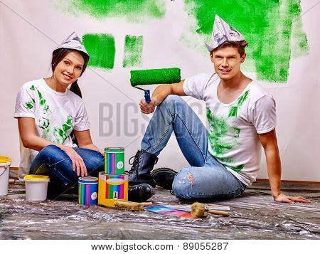 Happy family paint wall at home. Green paint.