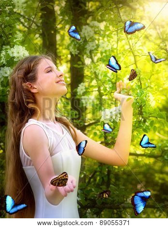 Beautiful girl with butterfly in summer forest. Romantic style.