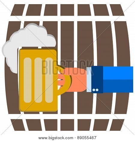 Mug Of Beer With Foam Head In His Hand On A Background Of Beer Barrels