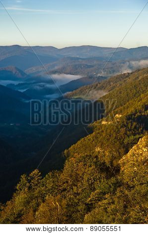 Foggy valley at autumn sunrise, Cemerno mountain