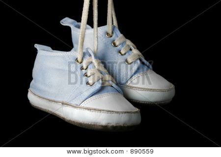 Baby Boy Shoes On A Black Background