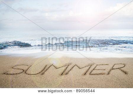 Summer Word Written On Sand Beach With Sky Clouds Sunlight