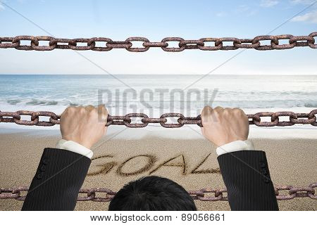 Businessman Climbing On Iron Chains With Goal Word Sand Beach