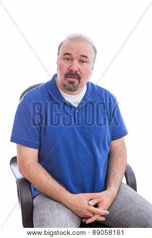Amazed Middle Age Man Sitting On A Chair