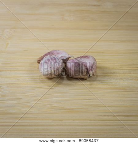 Garlic Cloves On Chopping Board