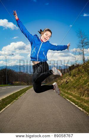 Teenage girl running, jumping outdoor