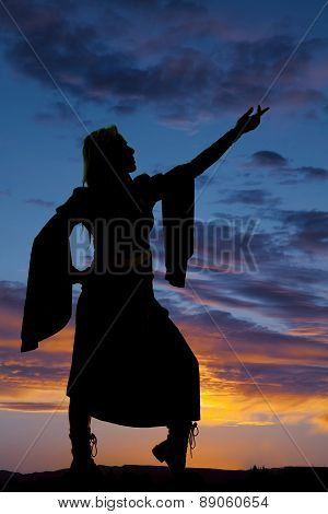 Silhouette Of A Woman With Dress And Flowing Arms Hand Up