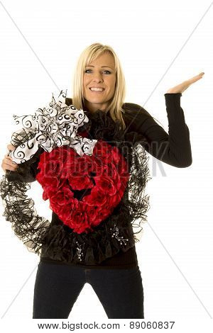 Woman Holding Heart Wreath Hand Up