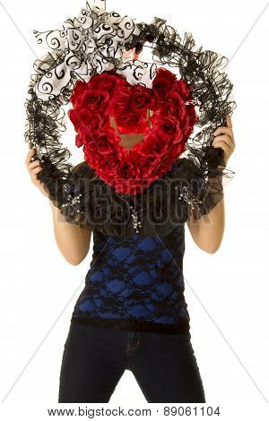 Woman Stand Behind Heart Wreath