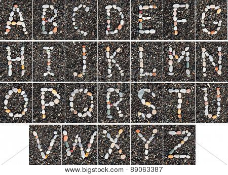 English letters of alphabet  laid on a black sand