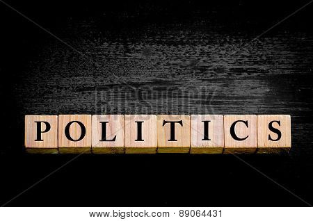 Word Politics Isolated On Black Background