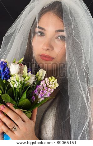 woman face with a bouquet of roses