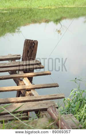 Old Wooden Bridge On The Lake