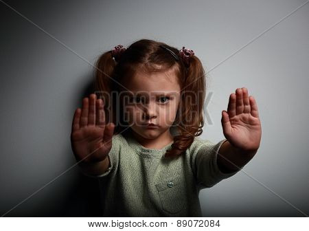 Kid Girl Showing Two Hands Signaling To Stop Violence And Pain