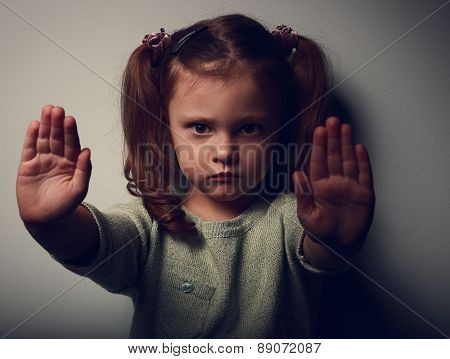 Kid Girl Showing Two Hands Signaling To Stop Violence. Closeup Portrait