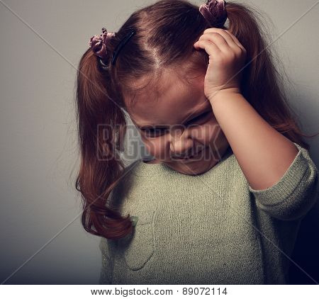 Stressed Kid Girl With Headache Holding The Head. Closeup Portrait