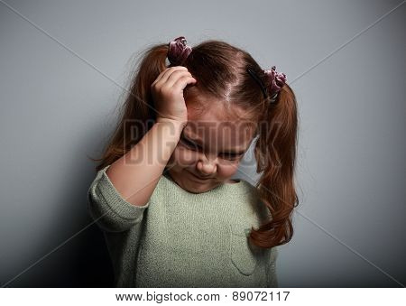 Stressed Kid Girl With Headache Holding Hand The Head