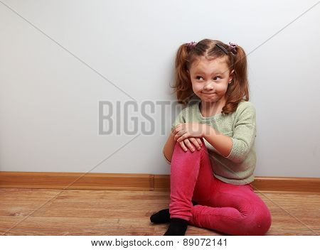 Thinking Humor Girl Sitting On The Floor With Fun Look