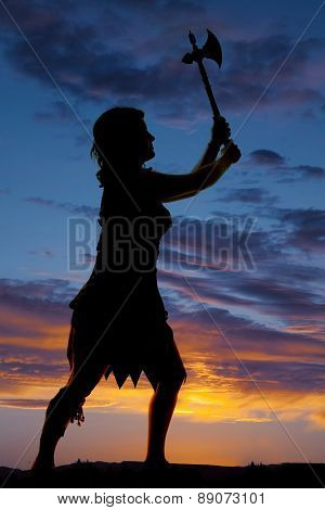 Silhouette Of A Cave Woman Hatchet In Air