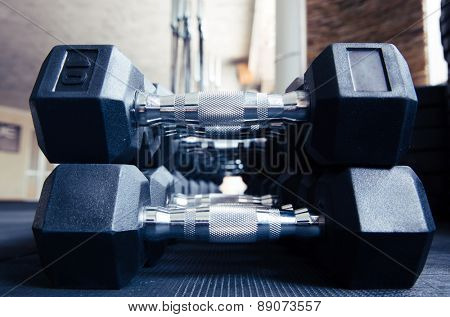 Closeup image of a dumbbells in gym
