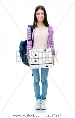 Full length portrait of a happy young female student with backpack and folders over white background. Looking at camera