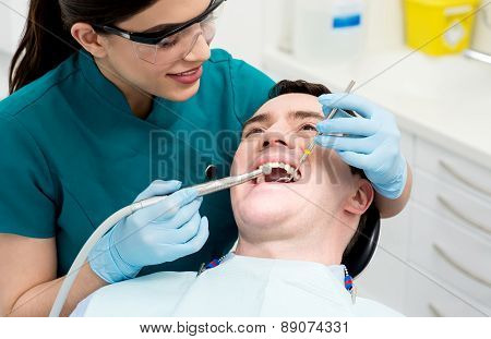 Male Getting His Teeth Examined.