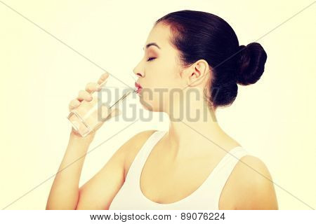 Young healthy woman drinking water