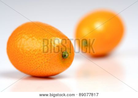Kumquat on white background - close-up