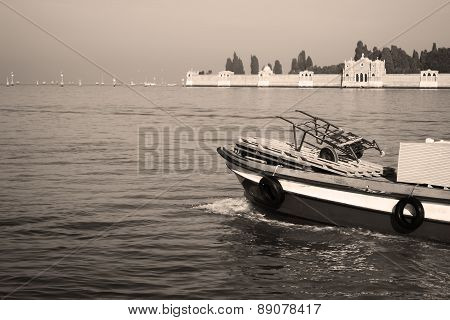 Small Freight Boat In Sepia Tone