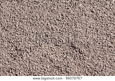Rough Crushed-stone Surface Of Brown Color
