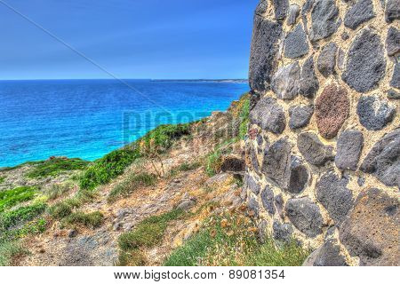 Brick Wall By The Shore In Sardinia