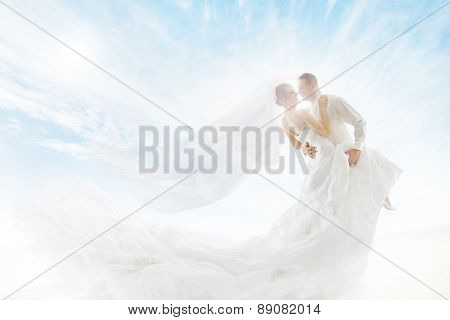 Bride And Groom Couple Dancing, Wedding Dress And Long Veil