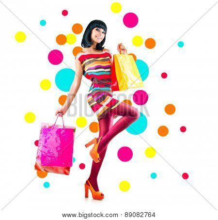 Full length portrait of fashion girl with shopping bags isolated on white background. Sales concept. Happy Beauty Woman with colorful Shopping Bags dancing. Shopper. Sale concept