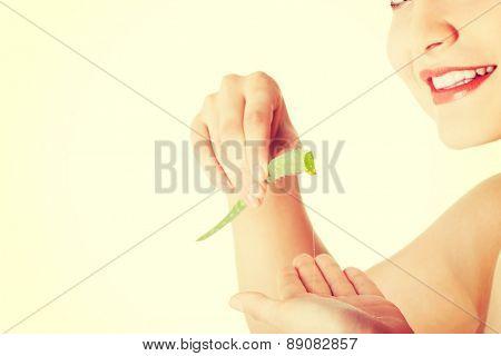 Young beautiful woman holding calla stem