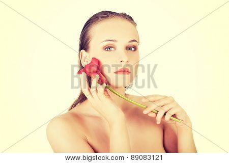 Young beautiful woman holding calla