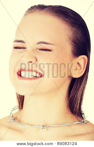 Young woman with throat pain
