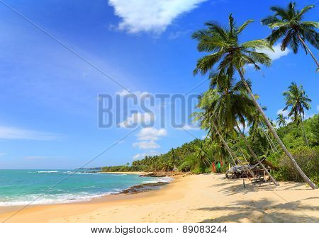 beautiful tropical beach landscape with clouds