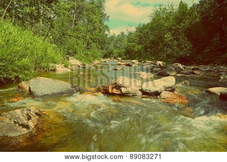 landscape with mountain river flowing over rocks at summer  - vintage retro style